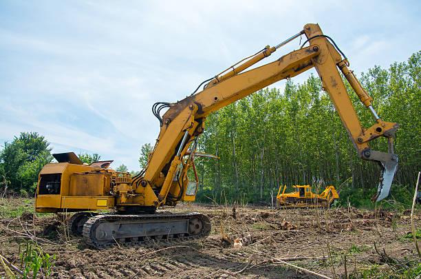 excavator clearing land